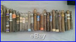 Small Rocky Patel humidor with Rocky Patel collectible cigar bands and
